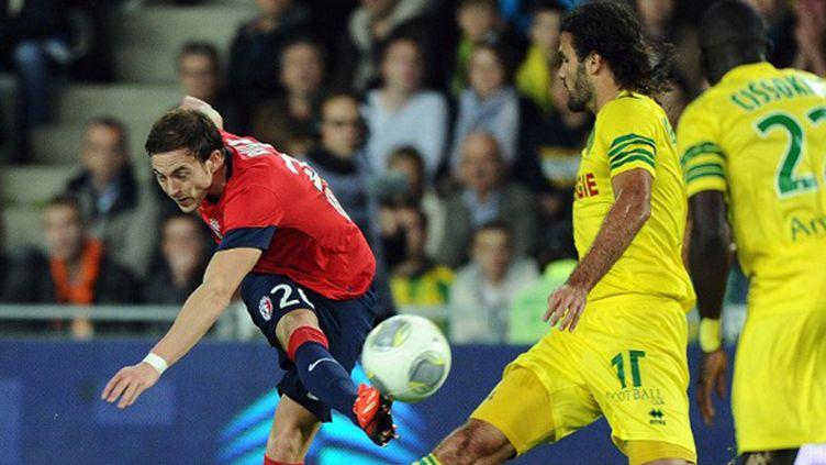 Nolan Roux a inscrit le seul but de la rencontre... alors qu'il était en position de hors-jeu. (JEAN-SEBASTIEN EVRARD / AFP)
