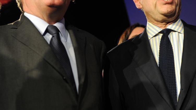 Le président du MoDem, François Bayrou, et le maire UMP de Bordeaux, Alain Juppé, le 8 mars 2014 à Pau (Pyrénées-Atlantiques). (GAIZKA IROZ / AFP)