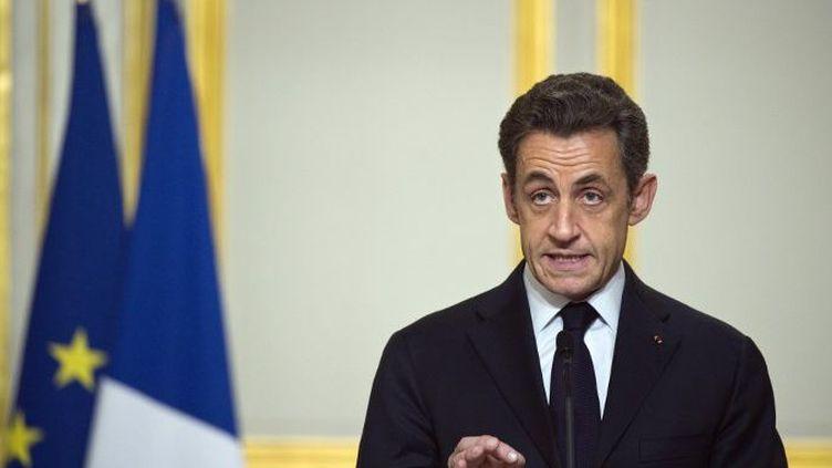 Nicolas Sarkozy le 19 mars 2011 à l'Elysée. Le président français annonce le lancement de l'intervention française en Libye, sous mandat onusien.  (LIONEL BONAVENTURE / POOL / AFP)