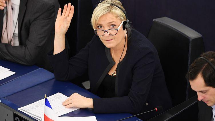 La présidente du Rassemblement national Marine Le Pen, lors d'un vote au Parlement européen, à Strasbourg, le 22 novembre 2016. (FREDERICK FLORIN / AFP)