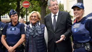 Patrick et Isabelle Balkany le 7 mai 2015 à Levallois-Perret. (BERTRAND GUAY / AFP)