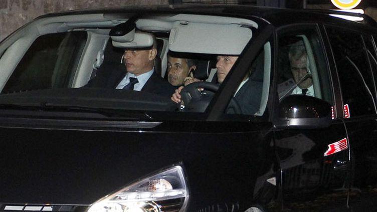 (Nicolas Sarkozy et son avocat Thierry Herzog sortant du tribunal de Bordeaux le 22 novembre 2012. © REUTERS/Regis Duvignau)
