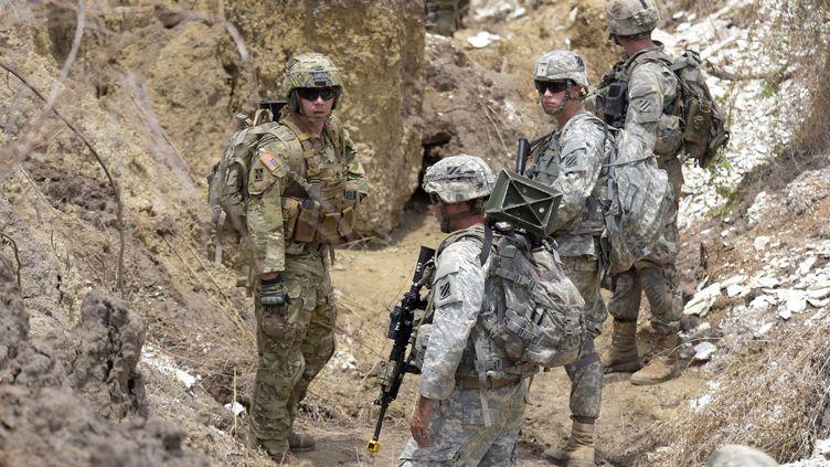 Militaires américains lors de manœuvres conjointes avec des soldats sénégalais à Thiès (70 km à l'est de Dakar), le 25 juillet 2017. (SEYLLOU / AFP)