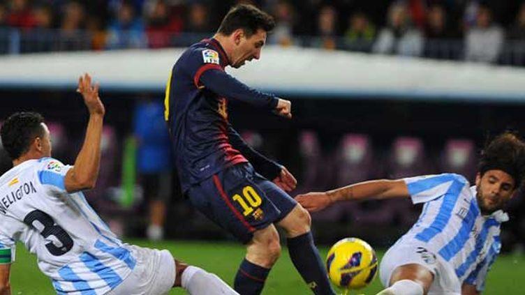 Messi essaie de se sortir de la tenaille de Malaga