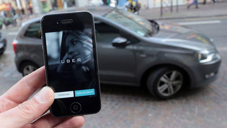 (L'application pour smartphones UberPop dans le collimateur de la justice © MAXPPP)
