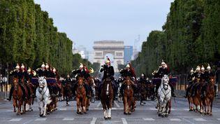 LaGarde républicaine lors d'une répétition du défilé du 14-Juillet, le 9 juillet 2021 sur les Champs-Elysées à Paris. (BERTRAND GUAY / AFP)