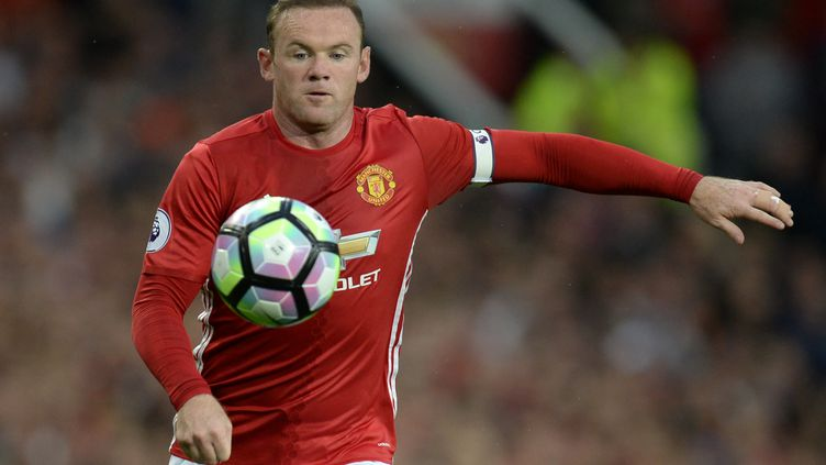 Wayne Rooney fidèle au maillot rouge de Manchester (OLI SCARFF / AFP)