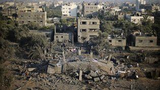 Des raids aériens israéliens ont détruit des maisons dans la bande de Gaza, le 8 juillet 2014. (REUTERS / MOHAMMED SALEM)