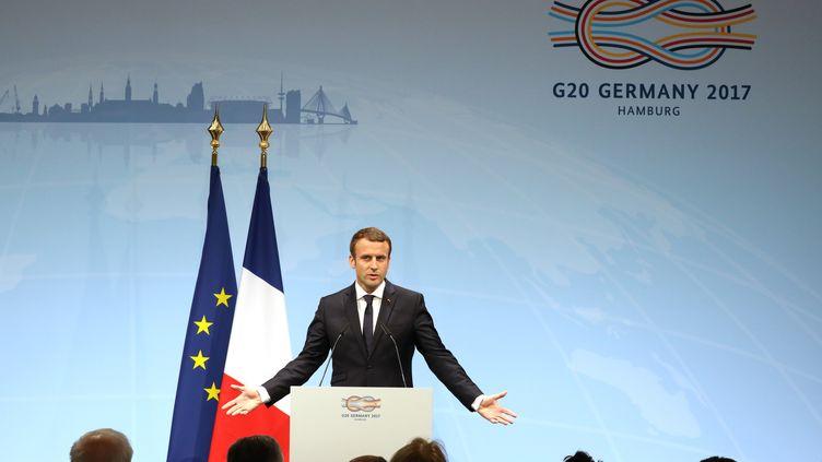 Emmanuel Macron a réussi à imposer la voix de la France sur le commerce et l'Accord de Paris, au G20 à Hambourg. (LUDOVIC MARIN / AFP)