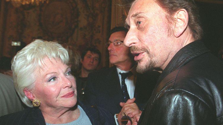 Line Renaud etJohnny Hallyday,le 16 novembre 1999. (JEAN-PIERRE MULLER / AFP)