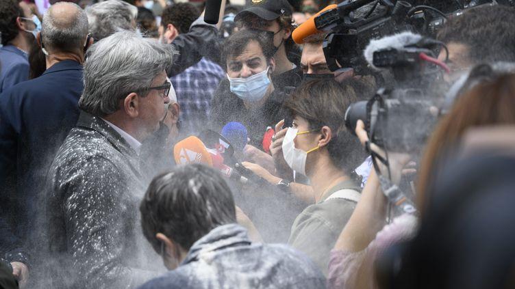Jean-Luc Mélenchon est enfariné, le 12 juin 2021, lors d'une manifestation contre l'extrême droite à Paris. (MAXPPP)