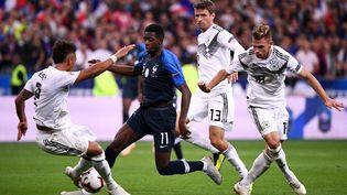 Ousmane Dembele face à l'Allemagne le 18 octobre dernier lors de la dernière rencontre des Bleus face à la Mannschaft. (FRANCK FIFE / AFP)