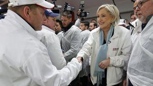 La candidate du Front national en visite au marché de Rungis (Val-de-Marne), mardi 25 avril 2017. (CHARLES PLATIAU / AFP)