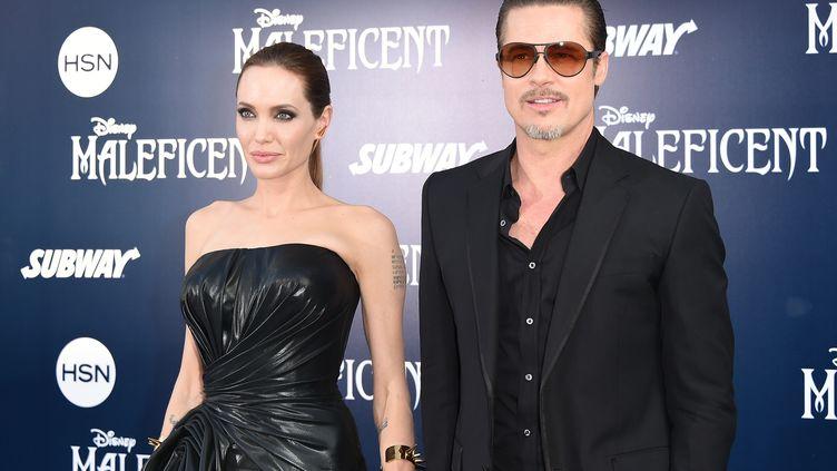"""Angelina Jolie et Brad Pitt lors de la première de """"Maléfique"""", à Hollywood (Californie), mercredi 28 mai 2014. (JASON MERRITT / GETTY IMAGES NORTH AMERICA / AFP)"""