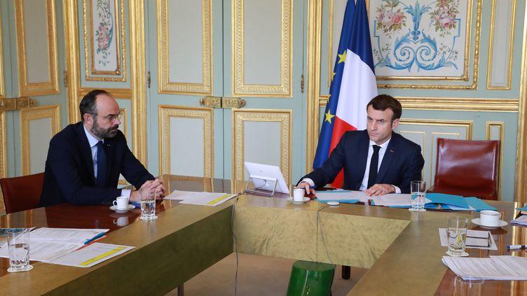 Edouard Philippe et Emmanuel Macron à l'Elysée, le 19 mars 2020. (LUDOVIC MARIN / AFP)