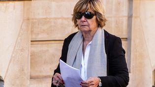 """La patronne de l'agence Bestimage, """"Mimi"""" Marchand,assiste à la cérémonie d'obsèques de Charles Aznavour, le 6 octobre 2018. (CHRISTOPHE PETIT TESSON / EPA)"""