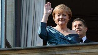 La chancelière Angela Merkel et son mari Joachim Sauer à l'ouverture du Festival Wagner deBayreuth, en Allemagne, le 25 juillet 2012. ( AFP PHOTO / CHRISTOF STACHE)