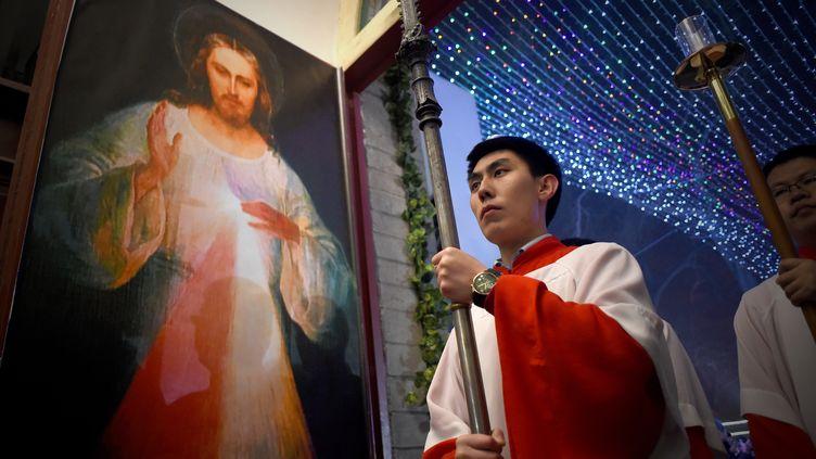 Comme dans cette église de Pékin, la messe de Noël est célébrée par des millions de citoyens chinois. (WANG ZHAO / AFP)