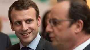 Emmanuel Macron et François Hollande lors d'une conférence à l'Elysée, le 2 mars 2016. (WITT / SIPA)