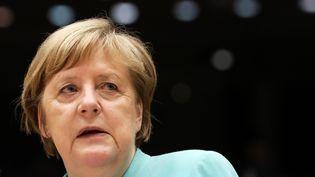 """Angela Merkel aura la tâche de convaincre les quatre pays dits """"frugaux"""" de signer l'accord européen de 750 milliards d'aides (YVES HERMAN / POOL)"""