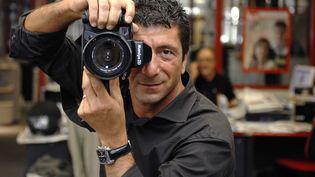 Le photographe Philippe Warrin à l'agence Sipa, le 21 mai 2007. (DURAND FLORENCE/ SIPA)