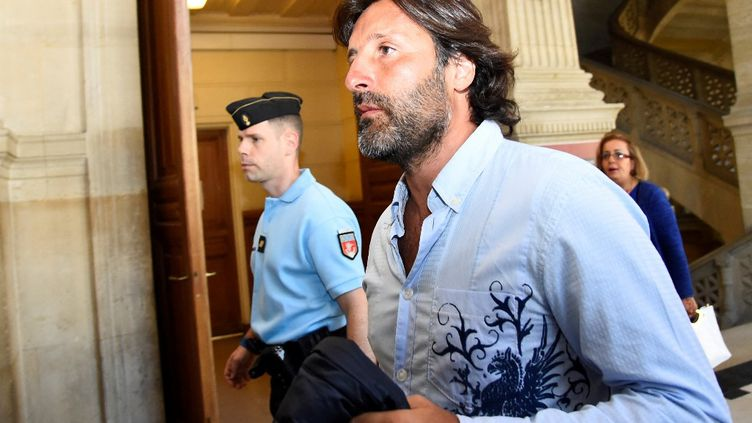 Arnaud Mimran arrive au palais de justice de Paris pourles délibérations de son procèssurl'escroquerie présumée à la taxe carbone, le7 juillet 2016. (BERTRAND GUAY / AFP)