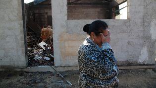 La famille Santiago a perdu une maison dans l'incendie près de Vitrolles (Bouches-du-Rhône), le 11 août 2016. (MAXPPP)