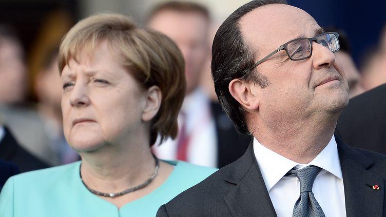 Angela Merkel et François Hollande au sommet de l'OTAN à Varsovie en Pologne le 8 juillet 2016 (STEPHANE DE SAKUTIN / AFP)