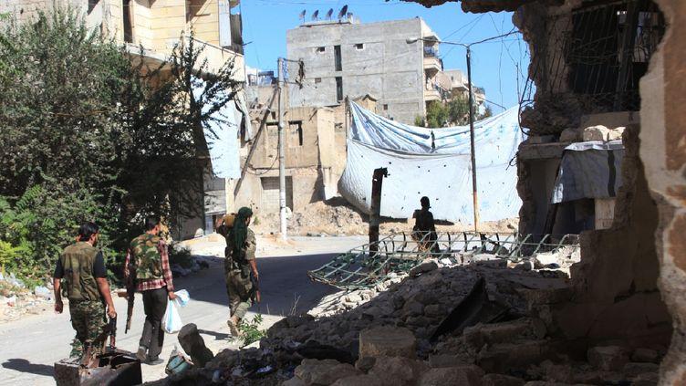 Des forces pro-régimes à Alep (Syrie), le 30 septembre 2016. (GEORGES OURFALIAN / AFP)