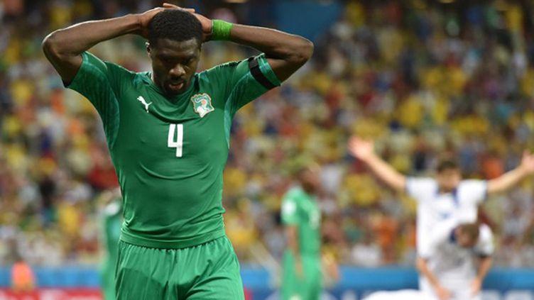 L'immense déception de l'Ivoirien Kolo Touré (ARIS MESSINIS / AFP)