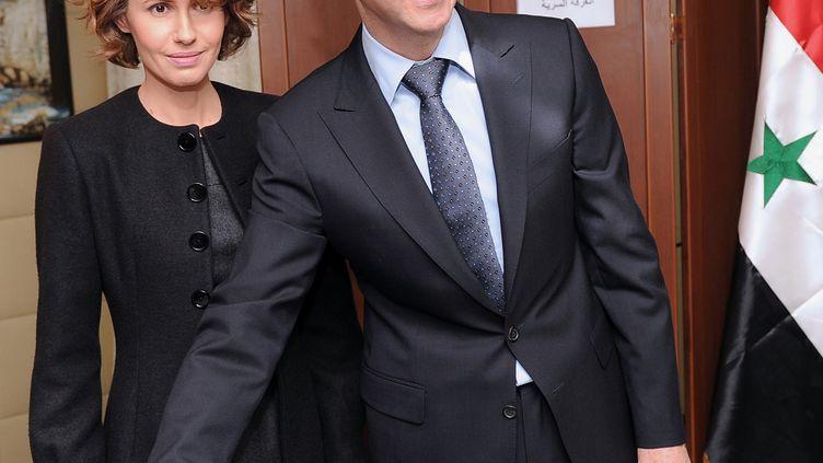 Le couple Al-Assad, le 26 février 2012 à Damas (Syrie). (SANA / AFP)