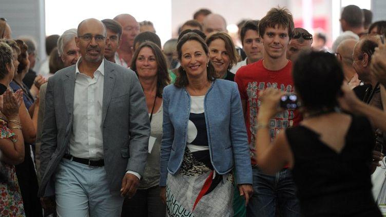 Harlem Désir et Ségolène Royal lors de l'ouverture de l'université d'été du PS à La Rochelle (Charente-Maritime), le 23 août 2013. (XAVIER LEOTY / AFP)