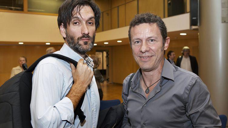 """Le photographe indépendant, Ricardo García Vilanova, ete journaliste du quotidien espagnol """"El Mundo"""", Javier Espinosa, le 11 décembre 2013 à Barcelone (Espagne). (JOAN BORRAS / PRH / AFP)"""