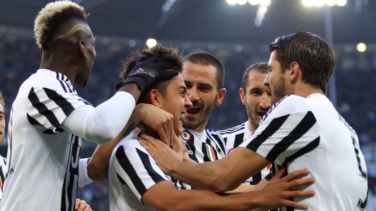 La joie des Turinois autour de Paulo Dybala et Paul Pogba (MARCO BERTORELLO / AFP)