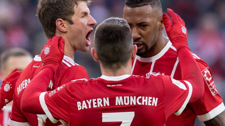 Thomas Müller, Franck Ribéry et Jerome Boateng célèbrent un but  (SVEN HOPPE / DPA)