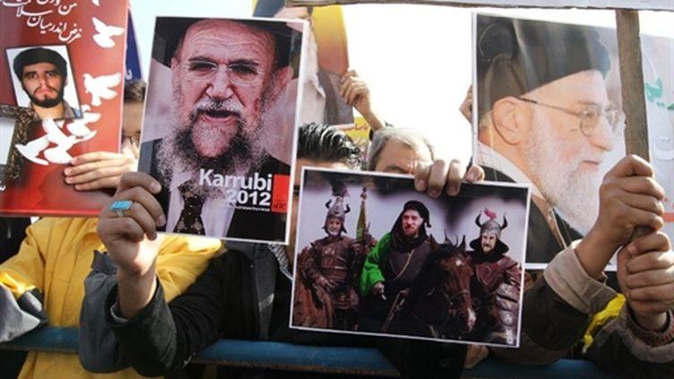 Les partisans du régime iranien manifestent à Téhéran contre l'opposition, vendredi 18 février 2011. (AFP - Atta Kenare)