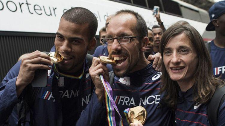Benjamin Compaoré, Yohann Diniz et Christelle Daunay (FRED DUFOUR / AFP)