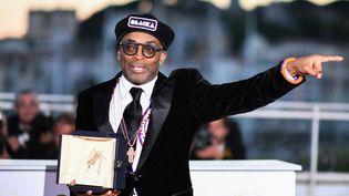 """Le réalisateur américain Spike Lee, récompensé du Grand Prix pour """"BlacKkKlansman"""", au Festival de Cannes, le 19 mai 2018. (ANNE-CHRISTINE POUJOULAT / AFP)"""