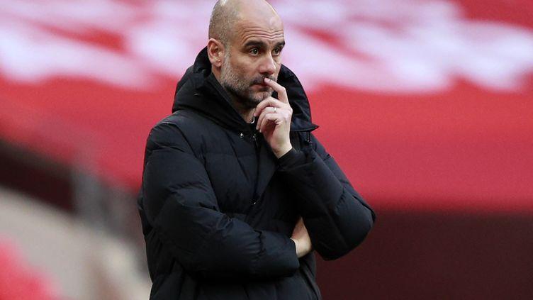 Pep Guardiola sur le banc de Manchester City (IAN WALTON / POOL)