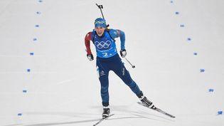 La biathlète françaiseAnais Bescond passe la ligne d'arrivée du relais dames aux Jeux olympiques dePyeongchang(Corée du Sud), le 22 février 2018. (JONATHAN NACKSTRAND / AFP)