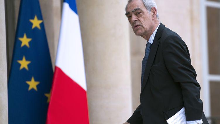 L'ex-secrétaire d'Etat socialiste, Henri Emmanuelli, le 21 mars 2013, sur le perron de l'Elysée (Paris). (FRED DUFOUR / AFP)