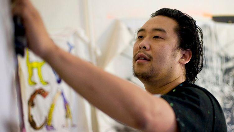 L'artiste David Choe dans son studio de New York (Etats-Unis), le 28 mai 2009. (RAMIN TALAIE / BLOOMBERG / GETTY IMAGES)