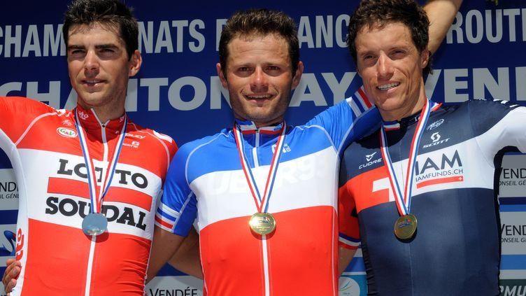 Le podium 2015 du championnat de France: Gallopin (2e), Tronet (1er) et Sylvain Chavanel (3e) (FRED TANNEAU / AFP)