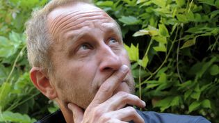 """Le comédien belgeBenoit Poelvoorde, le 13 juin 2013 à Lille (Nord) pour la promotion du film""""Le Grand Mechant Loup"""". (FRANCOIS LO PRESTI / AFP)"""
