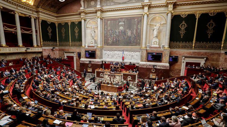"""Le Premier ministre Edouard Philippe s'adresse aux députés à propos du """"grand débat national"""", le 9 avril 2019 à l'Assemblée nationale. (THOMAS SAMSON / AFP)"""