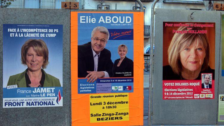 Les affiches de campagne des candidats FN, UMP et PSde la 6e circonscription de l'Hérault, à Béziers, le 4 décembre 2012. (VIOLAINE JAUSSENT / FRANCETV INFO)