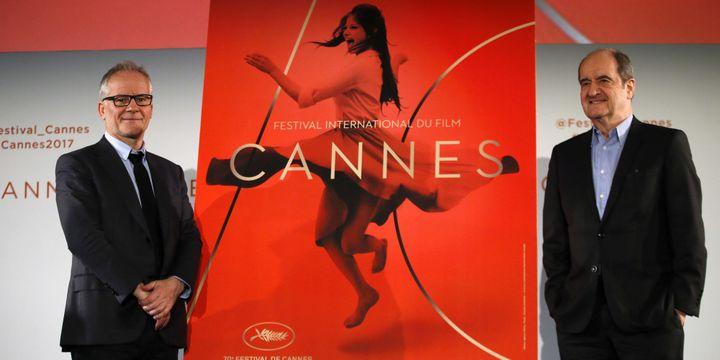 Thierry Frémaux, Délégué général, et Pierre Lescure, Président, devant l'affiche du 70e Festival de Cannes (2017).  (Francois Mori/AP/SIPA)