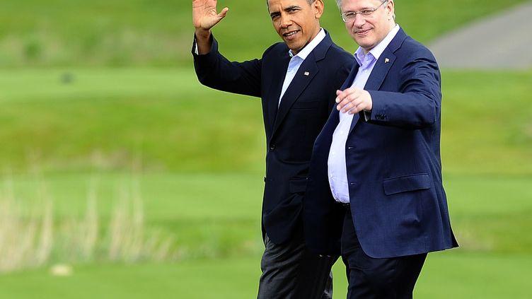 Le président américain, Barack Obama, et le Premier ministre canadien, Stephen Harper, le 18 juin 2013 à Enniskillen (Royaume-Uni). (JEWEL SAMAD / AFP)