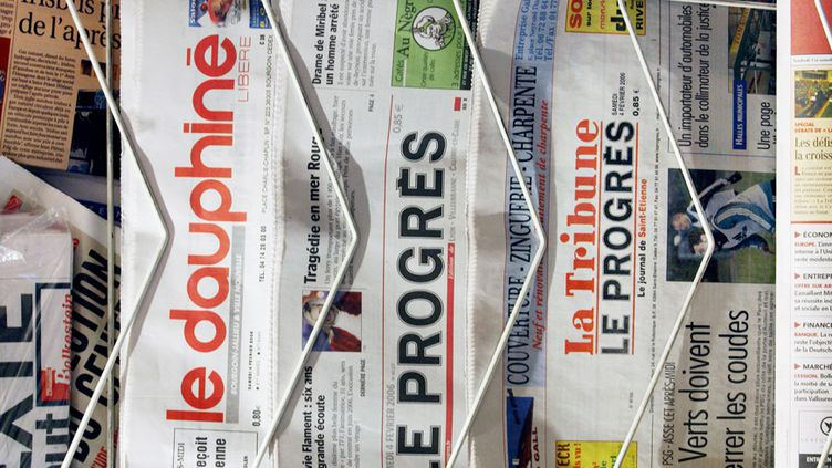 La presse se régale (PHILIPPE MERLE / AFP)