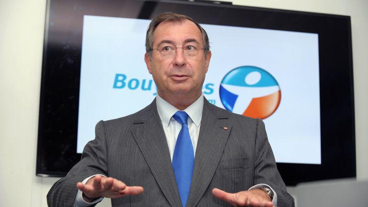 Martin Bouygues à Meudon (Hauts-de-Seine), le 1er octobre 2013, pour le lancement de son réseau 4G. (ERIC PIERMONT / AFP)